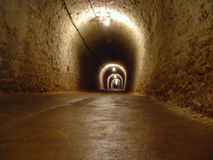 Tunnel in a salt mine. Dark long tunnel in a salt mine Royalty Free Stock Photo