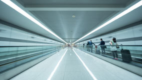 Tunnel at Seoul airport with people on flat escalator Royalty Free Stock Image