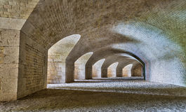 Tunnel with a series of arches . Royalty Free Stock Photo