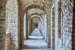 Tunnel with a series of arches . Royalty Free Stock Image
