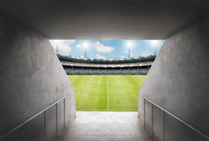 Tunnel in stadium with green field Royalty Free Stock Photo