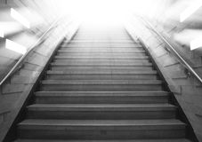 Tunnel Staircase going up to the light. Gray color monotone picture Royalty Free Stock Photos