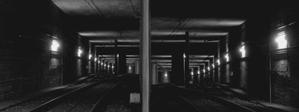 The tunnel of the subway. The dark tunnel deeply under the ground, an interval between stops Royalty Free Stock Images