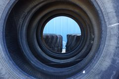Tunnel of tires waiting to be shipped Royalty Free Stock Photography