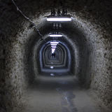 Tunnel to the center of the Earth. The entrance tunnel to the Turda Salt Mine Salina Turda, which goes some 850 meters down into the Earth. The mine functioned royalty free stock images