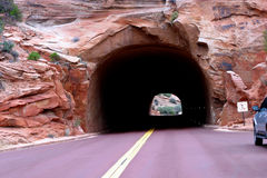 Tunnel to New Adventures. A tunnel in Zion National Park in Utah is carved out of natural red rock royalty free stock images