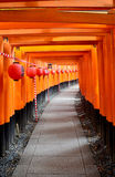 Tunnel of torii gates at Fushimi-Inari Shrine. People travel and walking path inside through a tunnel of torii gates at Fushimi-Inari Shrine on July 11, 2015 in Stock Image