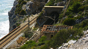 Tunnel and train tracks on the coast of El Garraf. Barcelona Royalty Free Stock Images
