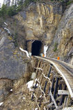 Tunnel and Trestle. Tunnel entrance and working trestle on the White Pass & Yukon Route railway between Whitehorse Yukon and Skagway Alaska Royalty Free Stock Photo