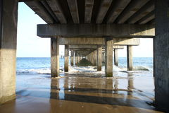 The tunnel under the bridge. Pier on the ocean stock photo