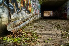 Old pedestrian tunnel with graffiti stock photo