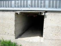 Tunnel under corn crib royalty free stock image