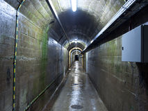 Tunnel under the dam Royalty Free Stock Photos
