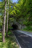 Tunnel under rock on mountain road Stock Photos