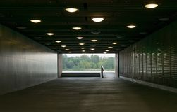 A tunnel or underpass with lights on the roof. royalty free stock image