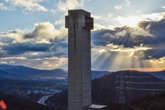 Tunnel ventilation tower in highway at dusk. stock photo