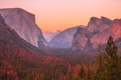 El Capitan golden hour. Tunnel View overlook at golden hour in Yosemite National Park. El Capitan and Half Dome at red sunset. Summer american holidays stock images