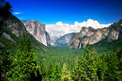Tunnel View, Yosemite National Park. Tunnel View at Yosemite National park offers a beautiful panorama of Yosemite Valley with El Capitan on the left, Bridalveil Stock Photos