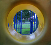 Tunnel Vision. An abstract view of a playground toy Stock Photo