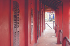 Tunnel walkway or footpath in old red buildings. Royalty Free Stock Photo