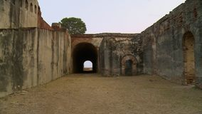 Tunnel in the wall of a fortress. A steady, medium shot of a tunnel made in a fortress wall defined by history on an arid land stock video
