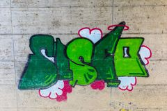 Tunnel wall painted with bright colorful graffiti stock images