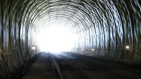 Tunneling. Building site tunnel. Car walks into light in a tunnel stock video