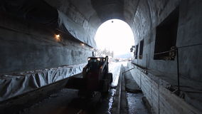 Tunneling. Bulldozer on construction site of highway tunnels stock video