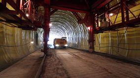 Tunneling process. Building site tunnel. Car walks into light in a tunnel stock footage
