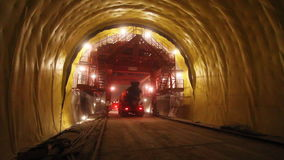 Tunneling process. Building site tunnel. Car walks into light in a tunnel stock video footage