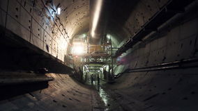 Tunneling process. Construction subway tunnel. A man walks through a tunnel stock video