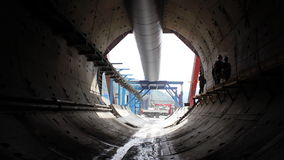Tunneling process. People in a tunnel. Building site stock video footage