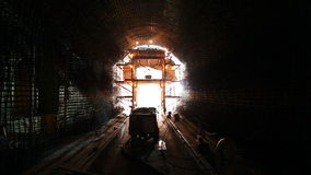 Tunneling process. Welders on construction site of highway tunnels stock video