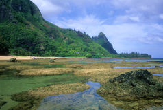Tunnels at low tide. Rocks and coral are exposed at low tide along beautiful Tunnels Beach on the north shore of Kauai, Hawaii Stock Photo