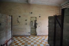 Room with plaid floor in Tuol Sleng Genocide Museum Stock Images