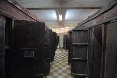 Compartments in Tuol Sleng Genocide Museum. Compartments with wooden doors in Tuol Sleng Genocide Museum, Phnom Penh, Cambodia Royalty Free Stock Photo