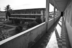 Tuol Sleng s21 genocide museum, Phnom Penh, Cambodia. Cambodia's notorious Tuol Sleng s21 secret prison- view from one cell block to another Royalty Free Stock Image
