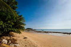Tup Kaek beach in Krabi. Beautiful view on Tub Kaak beach in Krabi region, Thailand. Landscape taken close to Ao Nang with blue sky and yellow sand Stock Images