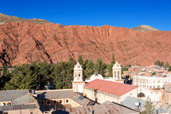 Tupiza Cathedral. Cathedral of Tupiza, Bolivia with beautiful red hills rising in the background Stock Photos