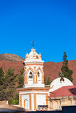 Tupiza Cathedral Spire. Spire of the cathedral in Tupiza, Bolivia with red hills in the background Stock Photography