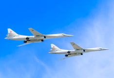 2 Tupolev Tu-22M3 (Backfire) supersonic  bombers. 2 Tupolev Tu-22M3 (Backfire) supersonic swing-wing long-range strategic and maritime strike bombers fly on Royalty Free Stock Photo