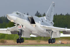 Tupolev Tu-22M3R bomber landing at Kubinka air force base. KUBINKA, MOSCOW REGION, RUSSIA - MAY 18, 2015: Tupolev Tu-22M3R bomber landing at Kubinka air force Stock Photos
