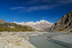 Tupopdan peaks and small river in Northern  Pakistan. Stock Images