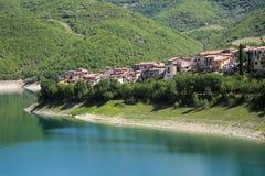 Turano lake, Colle di Tora city, near Rieti. View of Colle di Tora city, on Turano lake near Rieti in Lazio in Italy Royalty Free Stock Photography