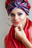 Turban and with artistic visage. Young woman in turban and with artistic visage and false eyelashes Royalty Free Stock Image