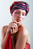 Turban and with artistic visage Stock Images