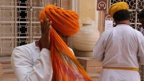 Turban. Indian man creates his turban stock video