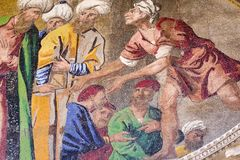 Close up detail of mosaic on St. Mark`s Basilica in Venice. Turbans denote the merchants of Egypt involved in the transition of St. Mark`s body to the Basilica Royalty Free Stock Photos