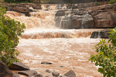 Turbid water of tropical waterfall after hard rain Stock Photo