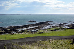 Turbidites on the coast of the western fjords in Iceland Royalty Free Stock Image